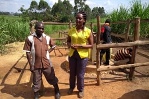 The Water Project: Rubona Kyagaitani Community -  The Field Officer Discussing Key Points With Chairperson Wsc