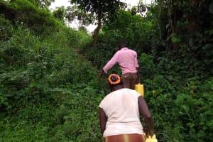 The Water Project: Ejinga-Ayikoru Community -  Carrying Water Back Home