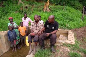 The Water Project: Ejinga-Ayikoru Community -  Field Officer Stephen With Community Members