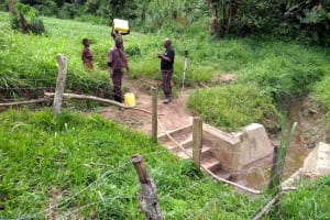 The Water Project: Abangi-Ndende Community -  Chatting With Community Members At The Spring