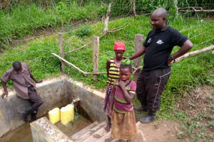 The Water Project: Abangi-Ndende Community -  Community Members Accessing The Water Point