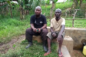 The Water Project: Karongo-Dum Community -  Field Officer Chatting With The Spring Care Taker