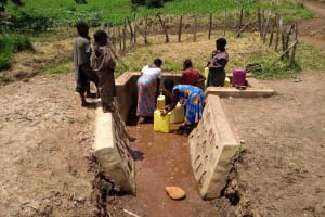 The Water Project: Rwempisi-Amanga Community -  Community Members Of Rwempisi Fetching Water