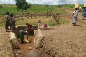 The Water Project: Rwempisi-Amanga Community -  People Coming And Going At The Spring