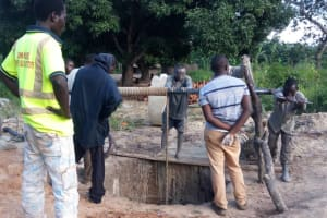The Water Project: Karagalya Kawanga Community -  Bailing And Cleaning The Well Out