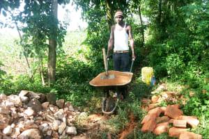 The Water Project: Mungakha Community, Nyanje Spring -  Community Member Brining Bricks