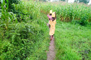 The Water Project: Bukhaywa Community, Asumani Spring -  Carrying Water Home