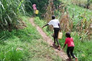 The Water Project: Musango Community, Mushikhulu Spring -  Carrying Water