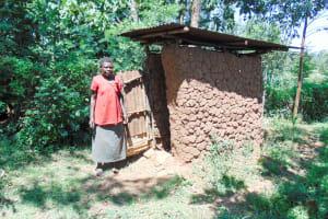The Water Project: Ibinzo Community, Lucia Spring -  Mud Latrine