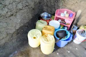 The Water Project: Emukoyani Community, Ombalasi Spring -  Water Storage