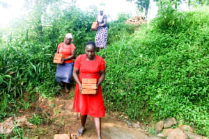 The Water Project: Mungakha Community, Nyanje Spring -  Carrying Bricks To The Site