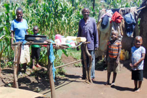 The Water Project: Ibinzo Community, Lucia Spring -  Family Stands By Dish Rack