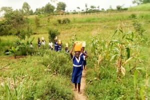 The Water Project: Musango Primary School -  Carrying Water