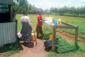 The Water Project: Namasanda Secondary School -  School Cooks Drying Dishes