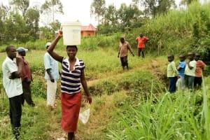 The Water Project: Musango Community, Emufutu Spring -  Carrying Water