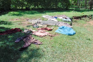 The Water Project: Ibinzo Community, Lucia Spring -  Clothes Drying On Ground