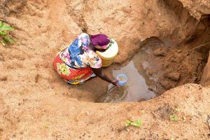 The Water Project: Kathamba Ngii Community -  Fetching Water