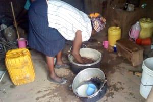 The Water Project: Musango Primary School -  School Cook In Kitchen