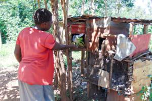The Water Project: Ibinzo Community, Lucia Spring -  Feeding A Bunny