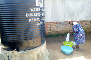 The Water Project: Matungu SDA Special School -  Washing Clothes At A Plastic Tank