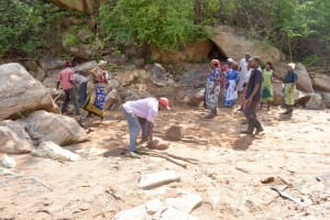 The Water Project: Ndithi Community -  Community Already Collecting Stones