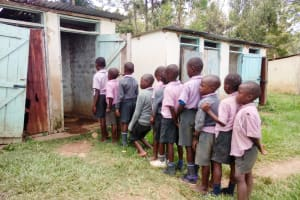 The Water Project: Mayoni Township Primary School -  Students Waiting For A Usable Latrine