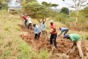 The Water Project: Kithoni Secondary School -  Clearing Land For The Tank