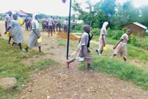 The Water Project: Ichinga Muslim Primary School -  Students Arriving At School With Water Containers