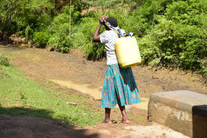 The Water Project: Mbau Community B -  Walking Home With Water