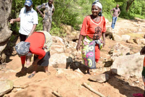 The Water Project: Mbau Community B -  Community Members Gathering Stones For More Water Points