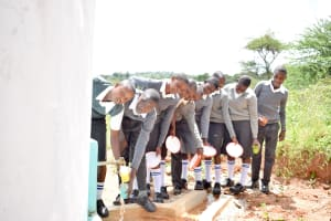 The Water Project: AIC Mbau Secondary School -  Water Flowing