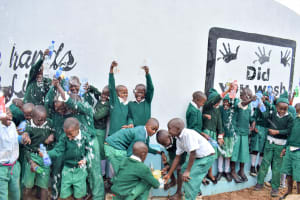 The Water Project: Kitooni Primary School -  Clean Water Flowing