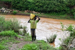 The Water Project: Muluti Community -  Carrying Water