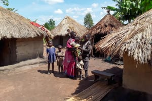 The Water Project: Karagalya Kawanga Community -  Kandole Irene With Her Family At Their Home