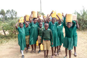 The Water Project: Elufafwa Community School -  Students Arriving At School With Water