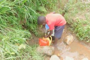 The Water Project: Eshiakhulo Community, Kweyu Spring -  Fetching Water