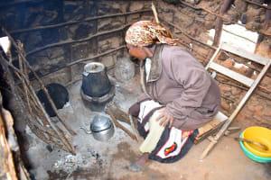 The Water Project: Kathamba Ngii Community A -  Mwikali Working In Kitchen