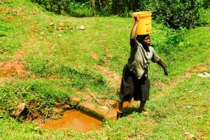 The Water Project: Wajumba Community, Wajumba Spring -  Carrying Water