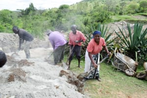 The Water Project: Mitini Community C -  Mixing Cement