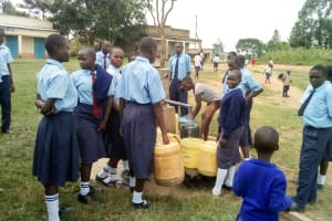 The Water Project: Musango Mixed Secondary School -  Waiting For Community Member To Finish