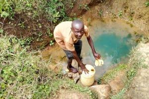The Water Project: Mukhuyu Community, Kwakhalakayi Spring -  Fetching Water