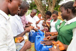 The Water Project: DEC Mathem Primary School -  Making Tippy Taps