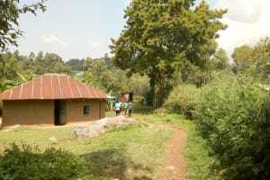 The Water Project: Chebunaywa Secondary School -  Passing Through A Homestead To Get Water