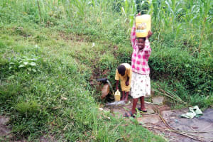 The Water Project: Bukhaywa Community, Asumani Spring -  Carrying Water