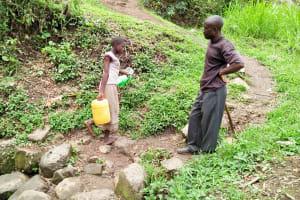 The Water Project: Munenga Community, Burudi Spring -  Carrying Water