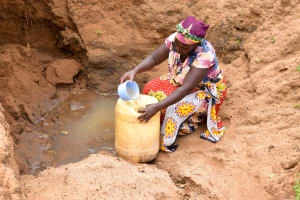 The Water Project: Kathamba Ngii Community A -  Fetching Water