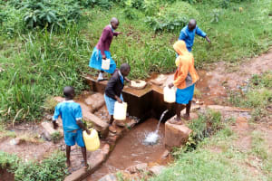 The Water Project: Kegoye Primary School -  Fetching Water