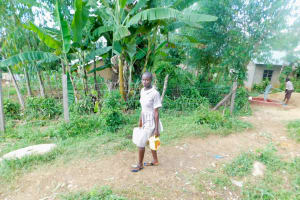 The Water Project: Ichinga Muslim Primary School -  Carrying Water Back To School