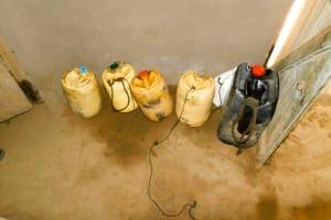 The Water Project: Munenga Community, Burudi Spring -  Water Storage