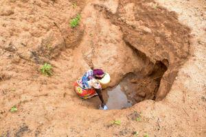 The Water Project: Kathamba ngii Community B -  Fetching Water